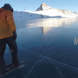 Black ice covers Lago Bianco with